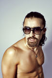Sexy naked guy in sunglasses Royalty Free Stock Photos