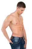 Sexy naked male model standing in jeans only. Holding hand in ba Royalty Free Stock Photos