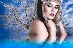 naked woman with winter hat Stock Images