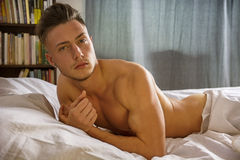 naked young man on bed Royalty Free Stock Images