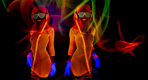Sexy neon uv glow dancer. Sexy female disco dancer poses in UV costume Stock Image