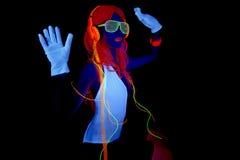Sexy neon uv glow dancer. Sexy female disco dancer poses in UV costume Stock Photos