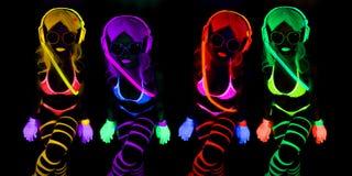 Sexy neon uv glow dancer. Sexy female disco dancer poses in UV costume Stock Photo