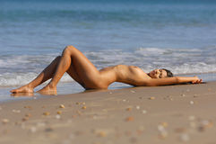 Sexy nude beach girl Royalty Free Stock Image