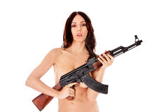 Sexy nude brunette girl model with weapon. Royalty Free Stock Image