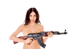 Sexy nude brunette girl model with weapon. Stock Photo