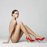 Sexy nude woman in shoes Stock Image