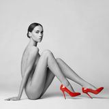 Sexy nude woman in shoes Stock Photography