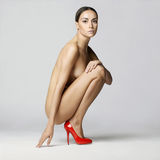 Sexy nude woman in shoes Stock Images