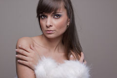 Sexy nude woman wearing fur hand warmer. Royalty Free Stock Image