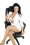 Sexy nurse on chair Royalty Free Stock Image