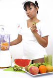 Sexy nurse holds lime and prepares fruit juice Royalty Free Stock Photography