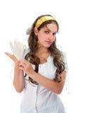Sexy nurse puts on latex glove Royalty Free Stock Image