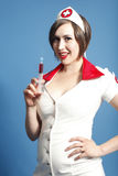 Sexy nurse with syringe Royalty Free Stock Photo