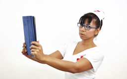 Sexy nurse uses an electronic tablet Royalty Free Stock Images