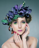 nymph pretty brunette in flowers crown stock photo