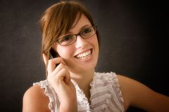 Office Girl Lucy. Office girl seductively pulling at her lip with her glasses Stock Image