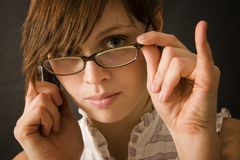 Sexy Office Girl Lucy. Sexy office girl seductively pulling at her lip with her glasses Stock Photos