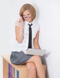 Sexy office worker. Sit with laptop on case Stock Images