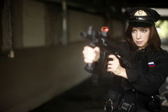 Sexy officer pointing gun Stock Images
