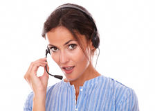 Sexy operator woman conversing on microphone Stock Photography