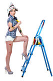 Sexy painter. Sexy woman painter in high heels shoes wiht ladder isolated on white background Royalty Free Stock Photos