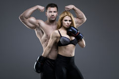 Sexy pair of athletic people Royalty Free Stock Images