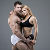Sexy pair of athletic people Stock Image