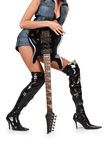 Sexy pair of legs in boots with electric guitar Royalty Free Stock Image