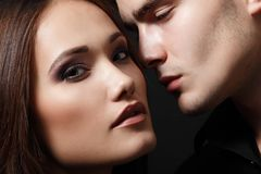 Passion couple, beautiful young female and male faces close. Up, studio shot Stock Photography