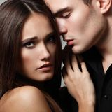 Passion couple, beautiful young female and male faces close. Up, studio shot Royalty Free Stock Photos