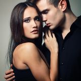 Passion couple, beautiful young man and woman closeup. Passion couple, beautiful young men and women closeup, studio shot royalty free stock photos