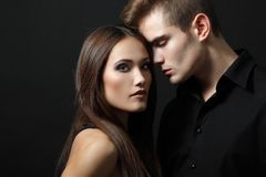 Passion couple, beautiful young man and woman closeup, over. Passion couple, beautiful young men and women closeup, studio shot over black royalty free stock images