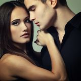 Passion couple, beautiful young man and woman closeup, stud. Passion couple, beautiful young men and women closeup, studio shot over black stock image