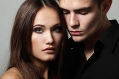 Passion couple, beautiful young man and woman closeup. Passion couple, beautiful young men and women closeup, studio shot over black stock image