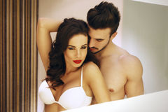 Sexy passionate couple in mirror Stock Photography