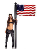 Sexy patriotic woman with an American flag Stock Photography