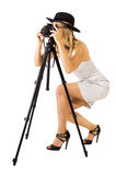 Photograher. Woman with a hat taking phptograph royalty free stock photography