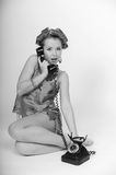 Sexy Pin Up Girl. Girl in Pin up pose & Fashion talking on the phone Stock Photography