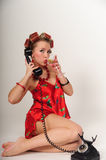 Sexy Pin Up Girl. Girl in Pin up pose & Fashion talking on the phone Royalty Free Stock Images