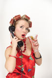 Sexy Pin Up Girl. Girl in Pin up pose & Fashion talking on the phone Royalty Free Stock Photo