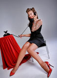 Sexy Pin Up Girl. Rockabilly Girl in Pin up pose & Fashion talking on the phone Stock Photos