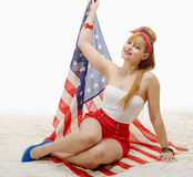 Sexy pin up girl with an American Flag Stock Photo