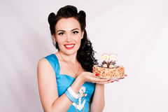 Sexy pin-up girl with a birthday cake. Twenty-five years. Royalty Free Stock Photography