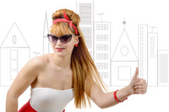 Sexy pin up  girl hitchhiking with sun glasses Royalty Free Stock Images