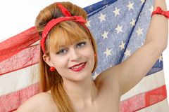 Sexy pin up girl  holding an American flag. Royalty Free Stock Photos