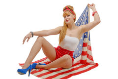 Sexy pin up girl  holding an American flag. Stock Image
