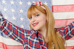 Sexy pin up girl  holding an American flag. Stock Photo