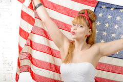 Sexy pin up girl  holding an American flag. A sexy pin up girl  holding an American flag Stock Photos