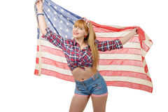 Sexy pin up girl  holding an American flag. Royalty Free Stock Image